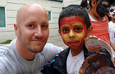 Dr. Jason Platt and a child participating in an annual camp designed to enhance self-esteem, build confidence and increase resiliency in Mexican youth. The annual day camp is hosted at Alliant International University's Mexico City campus.