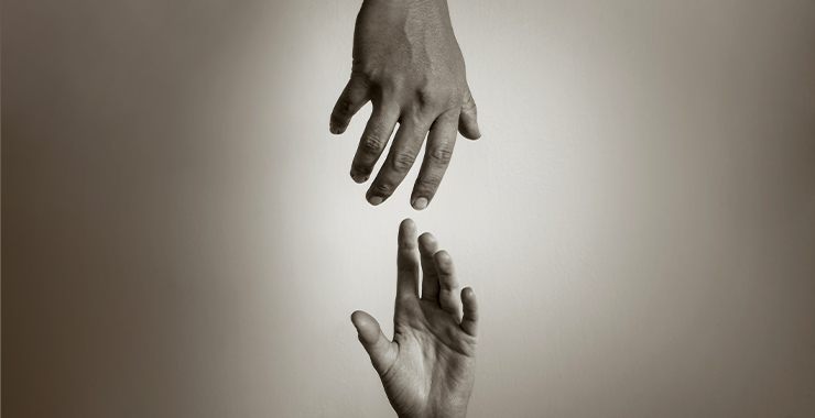 hands reaching for each other