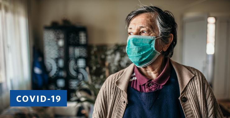 older man wearing a medical mask