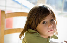 Girl sitting with a blank expression