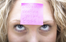 Woman with post-it note on forehead