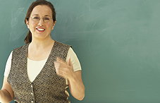 Woman standing in front of a chalk board