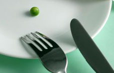 One green pea on a plate