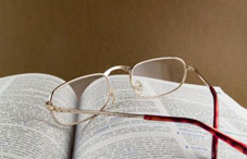 Eye glasses laying on an open book