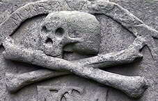 Headstone detail of skull and crossbones