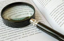 Magnifying glass on open book