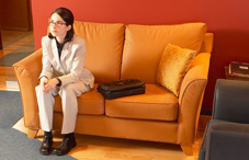 Woman sitting on orange couch