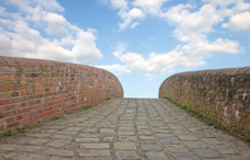 Brick wall and stone pathway