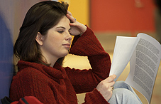 Young woman reading paperwork