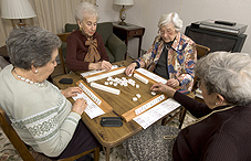 Elderly women playing scrabble