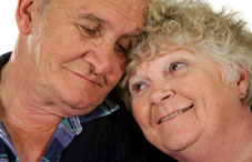 Elderly couple cuddling
