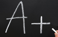 """A+"" written on chalkboard"