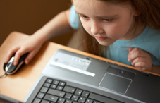 Young girl on a computer