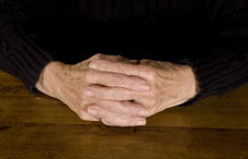 Pair of elderly hands together