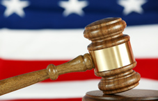 Gavel with American flag in the background