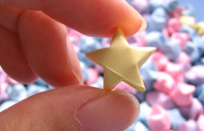 Hand holding picked star