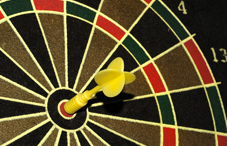 Dart in bullseye of dartboard