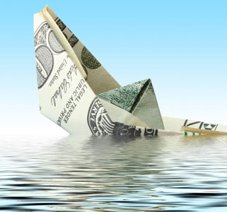 Money boat sinking in water