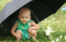 Child under umbrella