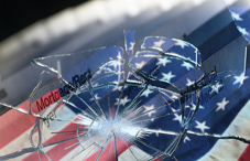 Broken glass over American flag