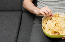 Eating chips on couch