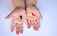 Child's hands with pills