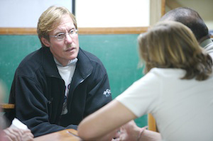 Dr. Stout talks with a group of people at San Pedro prison in La Paz, Bolivia