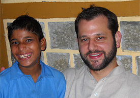 Seth Shaffer poses with a Harmony School student during his most recent visit to Dharamsala, India (2010)