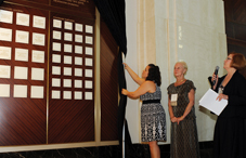 "APF's Kim Rowsome unveiled the wall of ""Visionary Circle"" donors at APF's reception. (credit: Stephanie Gross)"