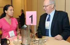 Dr. Pat DeLeon, right, coaches a mentee at this year's speed mentoring program. (credit: Lloyd Wolf)