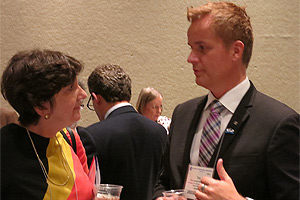 Tor Levin Hofgaard (right), President of the Norwegian Psychological Association, speaking with Ellen Garrison, APA Senior Policy Advisor, at the Pre-Opening Session Reception