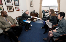 Members of the North Carolina Psychological Association share fact sheets with Laura Hooper, senior legislative aide for Rep. Melvin Watt (D-N.C.) highlighting the three key advocacy messages for the APA Practice Organization: Halting plummeting reimbursement rates for psychologists, including psychologists under Medicare's physician definition and making psychologists eligible for incentive payments in the HITECH Act. From left: Dr. Travis Colwell, Dr. Charles Cooper, Watt staffer Laura Hooper and Dr. Judith Patterson.