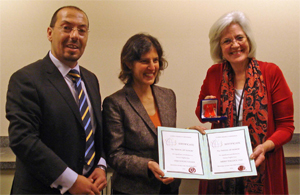 Ivan Karagyozov (left) presents recognition awards to Anju Khubchandani, Director of APA's Disability Issues Office (center), and Merry Bullock, Senior Director of APA's Office of International Affairs (right)
