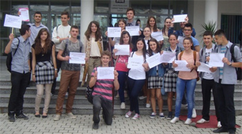 Blerta Sulhasi and a group of high school students carry signs cautioning against drug abuse