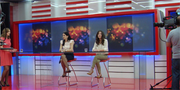 A representative from the Ministry of Education and Blerta Sulhasi (right) during a live television discussion on mental health