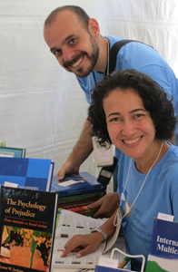 Brazilian graduate students arranging books at the APA booth.