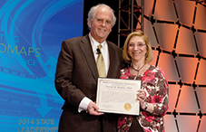 APA President Dr. Nadine Kaslow presents a presidential citation to Dr. David Barlow, founder and director emeritus of the Center for Anxiety and Related Disorders at Boston University.