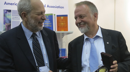 APA President Donald Bersoff conversing with SPF President Lars Ahlin during the MOU signing.