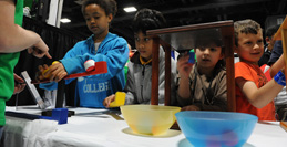 Participants at an exhibit jointly sponsored by the American Psychological Association and the Museum of Science, Boston, at the recent USA Science & Engineering Festival Expo