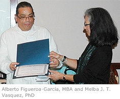 Alberto Figueroa-García, Assistant Director of the APA Office of Ethnic Minority Affairs receives award from Dr. Melba Vasquez, APA Past-President