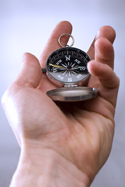 Hand with compass