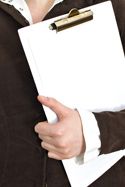 Closeup of woman holding a clipboard