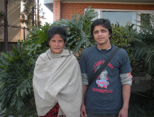 A recovered Seti poses with her son. With the rehabilitative assistance of Koshish, she was able to regain her memory and reunite with her family.