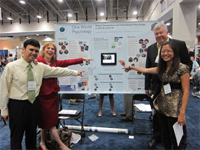 From left: Richard Velayo, Judy Kuriansky, John Hogan, and Rebecca Houran with the Division 52 (International Psychology) poster.