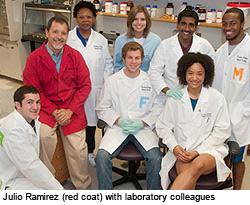 Julio Ramirez (red coat) with laboratory colleagues