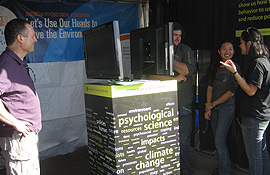 Visitors to the APA booth learn about psychological research on environmental behaviors