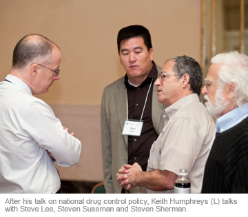 After his talk on national drug control policy, Keith Humphreys (L) talks with Steve Lee, Steven Sussman and Steven Sherman.