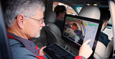 Dr. Strayer observes a driving test from the back seat of the research vehicle.