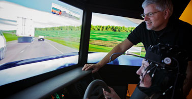 Dr. Strayer observes a subject in a driving simulator.